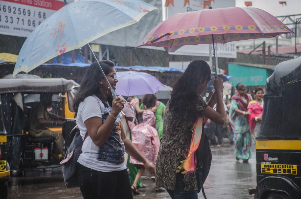 universal sisterhood mumbai girls in rain-1