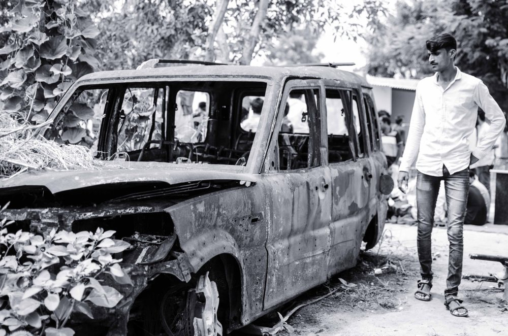 burnt down car in vadavli riot
