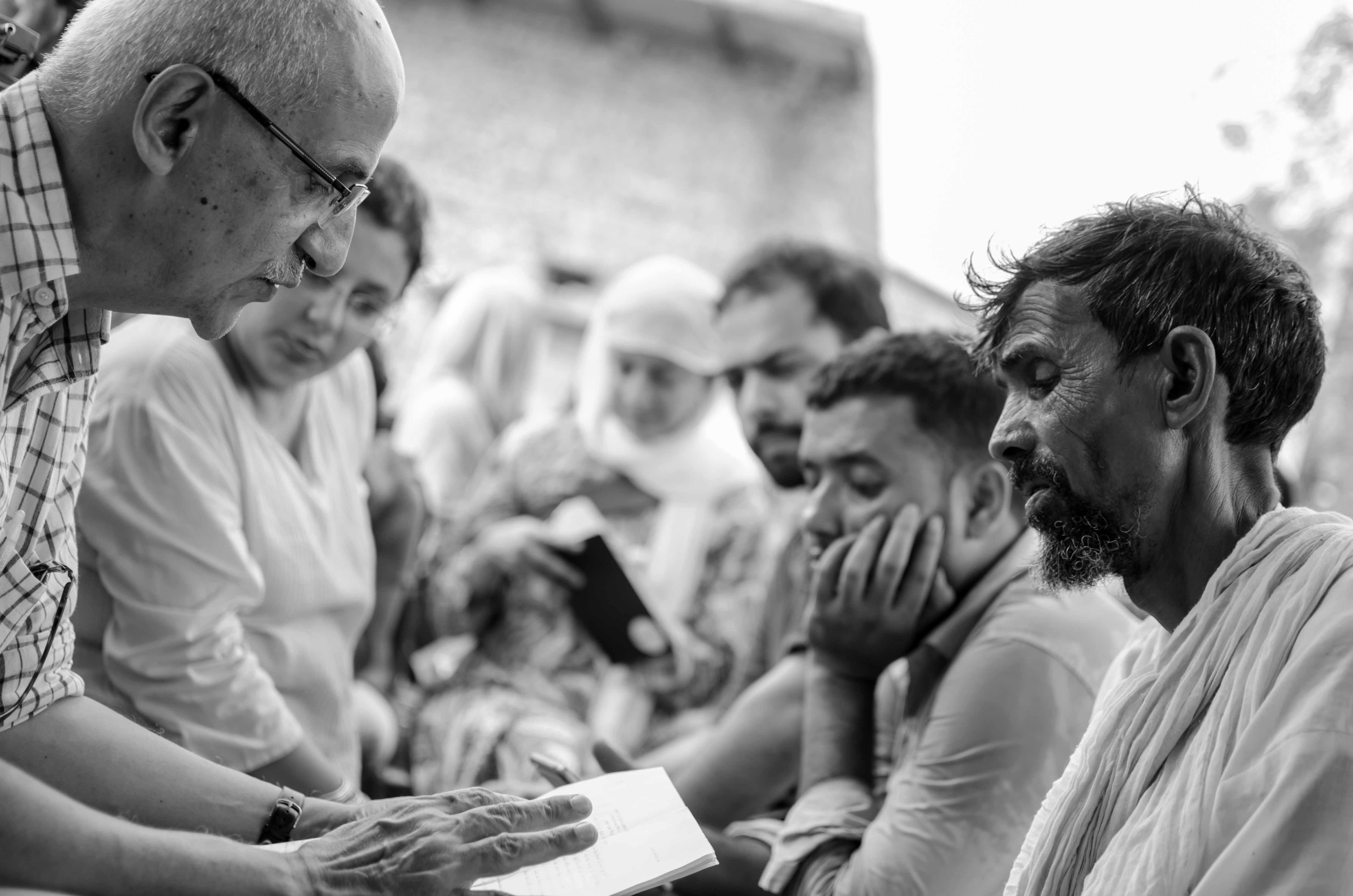Karwan members reading legal documents